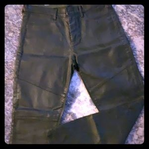 Leather look dark olive jegging pants.